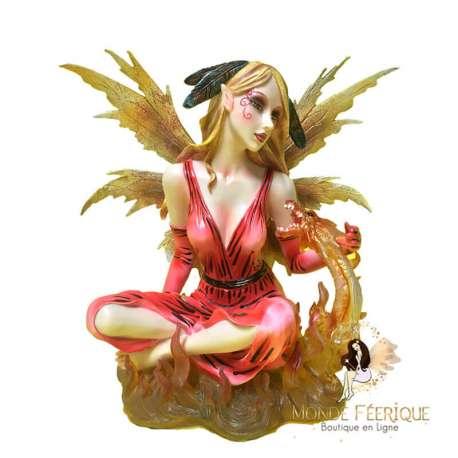 statuette fee avec un dragon rouge